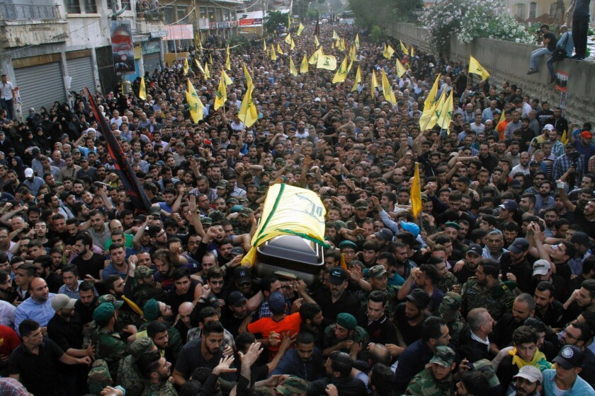 The coffin of Hezbollah leader Mustafa Badreddine is carried through the streets of Beirut in May.