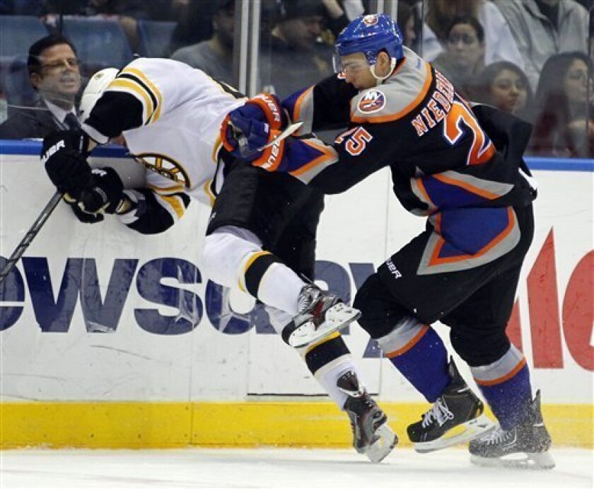 New York Islanders' Nini Niederreiter (25) checks Boston Bruins' David Krecji  during the second period of an NHL hockey game at the Nassau Coliseum in Uniondale, N.Y., Saturday, March 31, 2012. (AP Photo/Paul J. Bereswill)