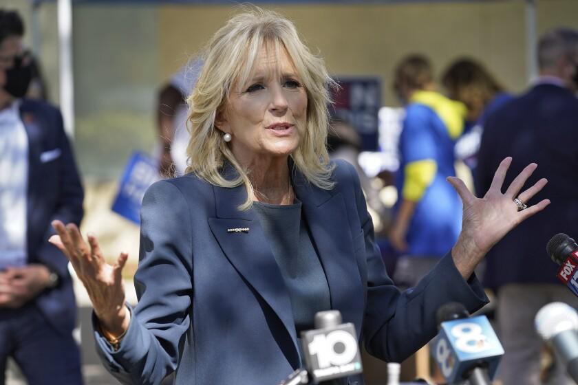 Jill Biden gesturing while speaking to reporters