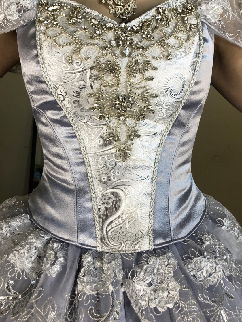 A close-up of the bodice of Cinderella's dress shows the intricate bead work by Mandy Pursley.