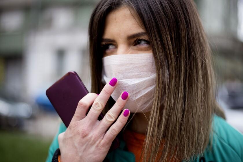 Women wearing hygienic mask to prevent the virus PM2.5 and Coronavirus.