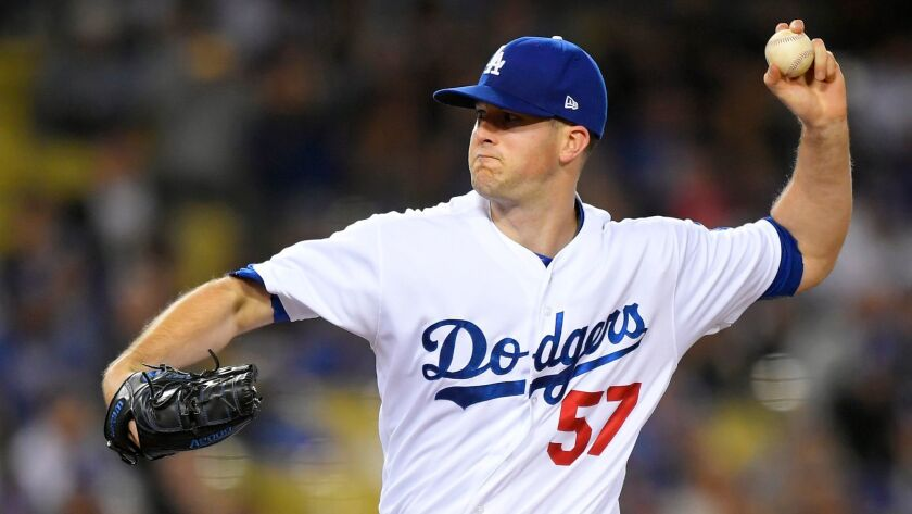 Los Angeles Dodgers starting pitcher Alex Wood throws to the plate during the third inning of a base