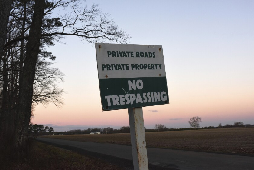A no-trespassing sign stands at the entrance to the road leading to a Russian diplomatic compound outside Centreville, Md.