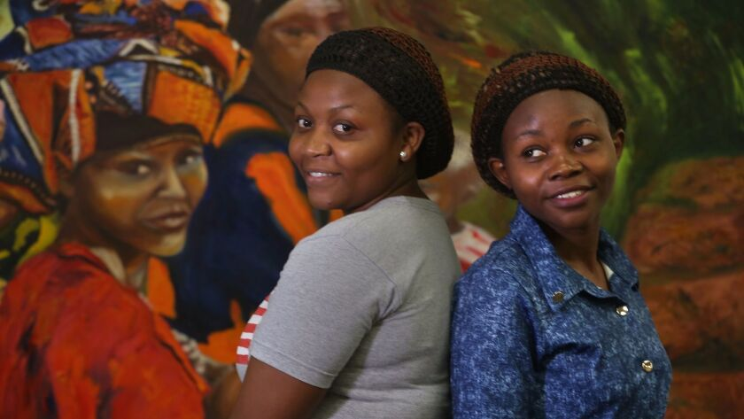 Emily Sifa Ngandu, 22, left, immigrated from Congo with her cousin Pendeza Batende, 21, right. After they arrived, they attended a class in February for recently immigrated refugees at the Alliance for African Assistance that addressed the culture shock of coming to America.