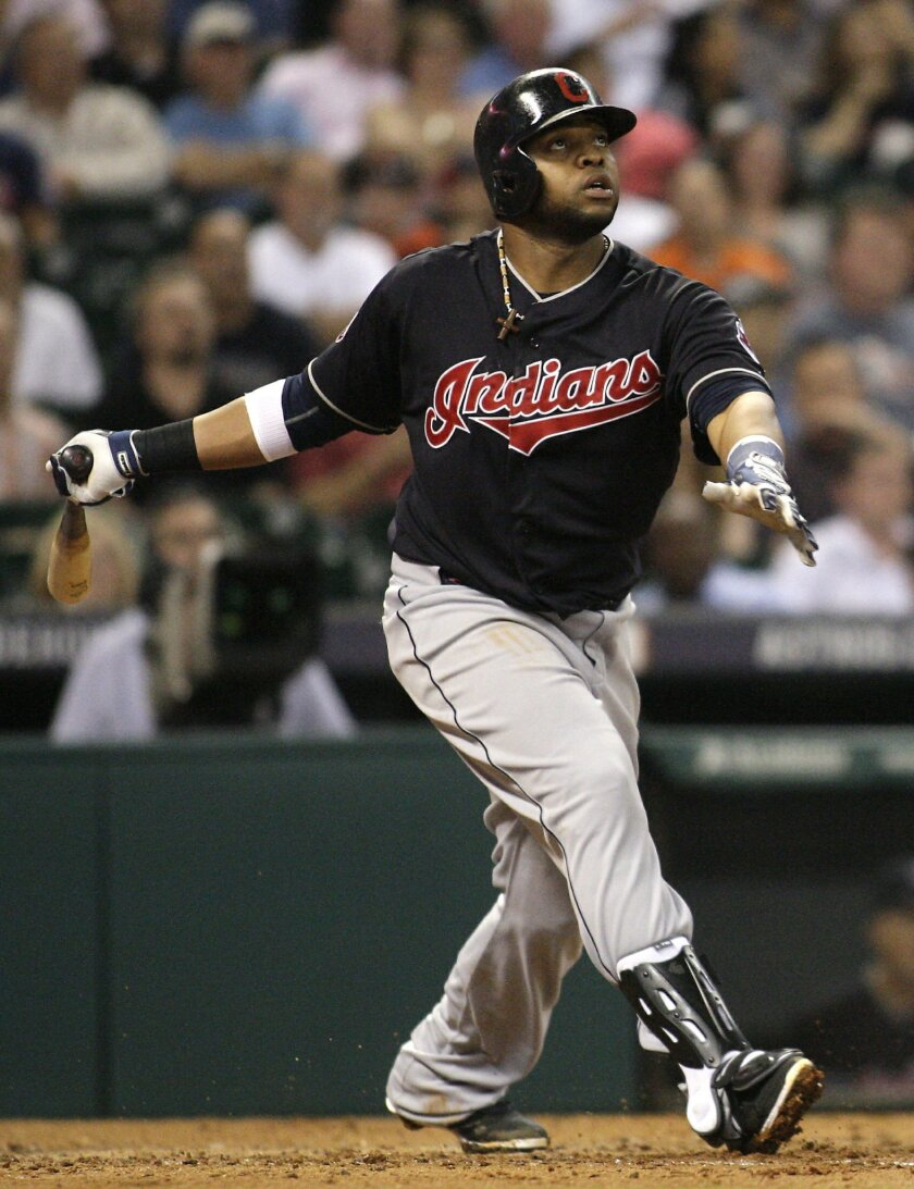 Cleveland Indians Carlos Santana hits a solo home run during the fourth inning of a baseball game against the Houston Astros, Wednesday, April 8, 2015, in Houston. (AP Photo/Patric Schneider)
