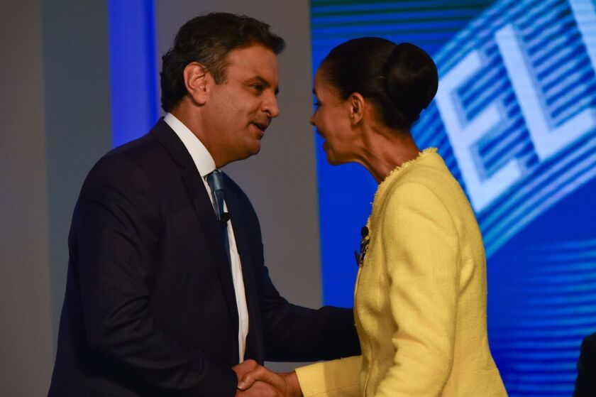 Brazilian presidential candidates Marina Silva and Aecio Neves greet each other in Rio de Janeiro before their last TV debate, on Oct. 2. Silva finished third in the first-round voting three days later.