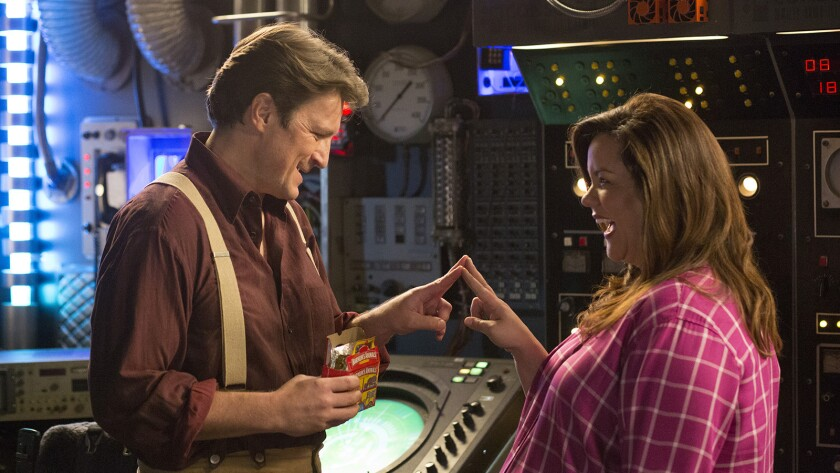 """Nathan Fillion and Katy Mixon in """"American Housewife"""" on ABC."""