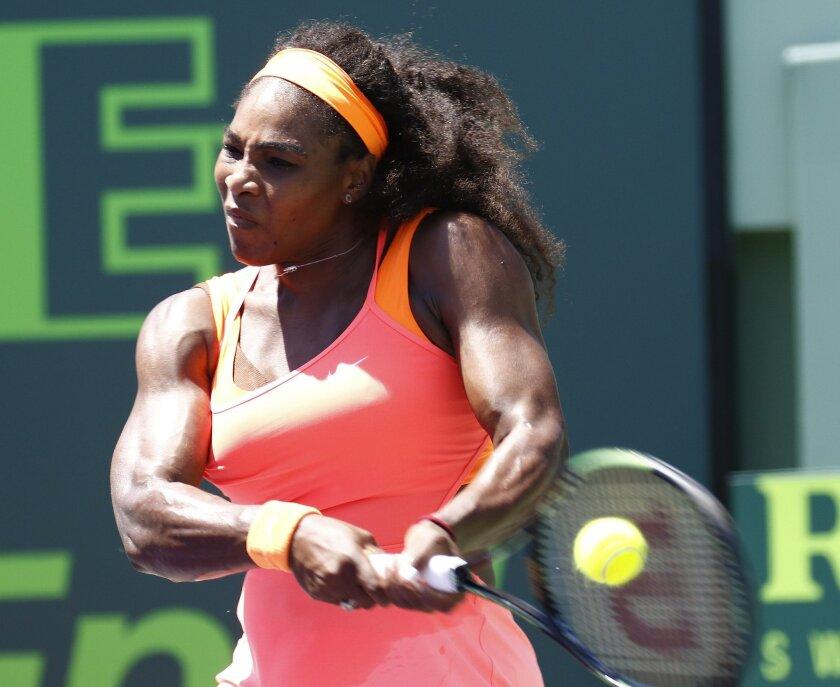 Serena Williams hits a return to Carla Suarez Navarro, of Spain, during the women's final at Miami Open tennis tournament in Key Biscayne, Fla., Saturday, April 4, 2015. Williams won 6-2, 6-0. (AP Photo/J Pat Carter)