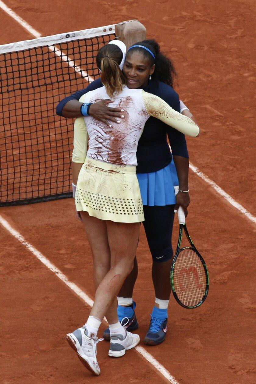Spain's Garbine Muguruza  hugs Serena Williams of the U.S.  after their final match of the French Open tennis tournament at the Roland Garros stadium, Saturday, June 4, 2016 in Paris.  Muguruza won 7-5, 6-4. (AP Photo/Christophe Ena)