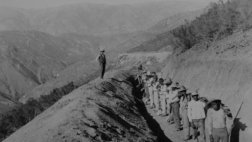 "This photo of the ""finishing"" workers laboring on the Escondido Canal shows Palomar Mountain in the distance; it was taken by Percy Cox in the 1890s."