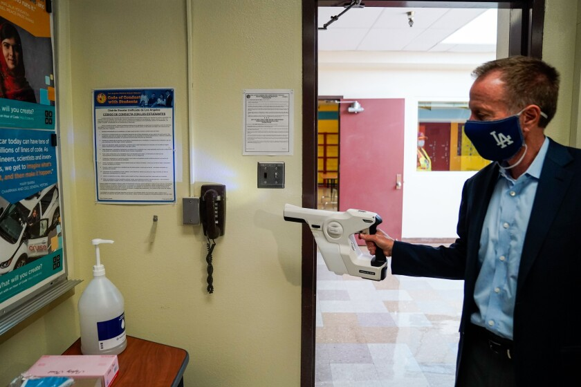 LAUSD Supt. Austin Beutner demonstrates the use of sanitizing tools while taking a tour of Burbank Middle School.