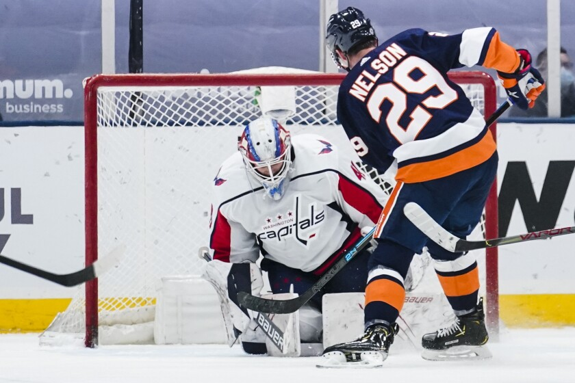 New York Islanders' Brock Nelson (29) shoots the puck past Washington Capitals goaltender Vitek Vanecek (41) during the third period of an NHL hockey game Tuesday, April 6, 2021, in Uniondale, N.Y. The Islanders won 1-0. (AP Photo/Frank Franklin II)