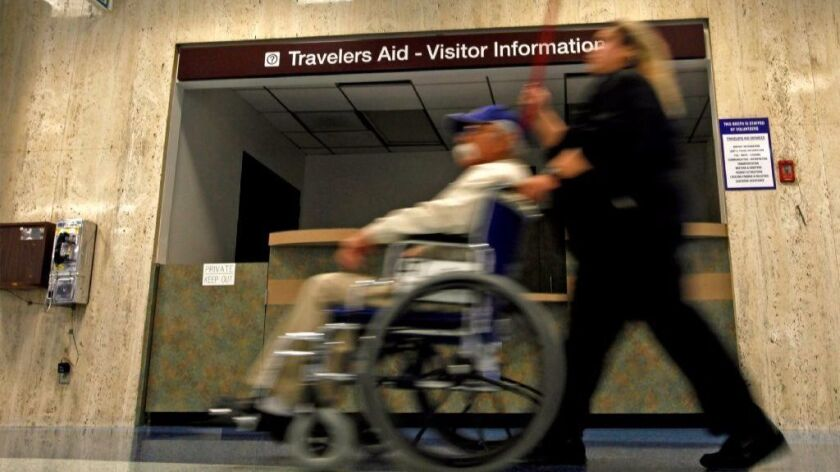 A traveler in a wheelchair at Los Angeles International Airport. The U.S. Transportation Department has delayed implementing a rule to force airlines to keep track of passenger wheelchairs.