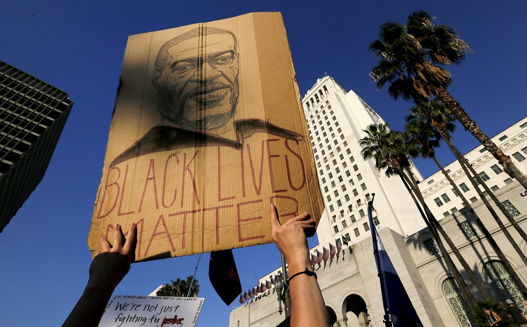 Thousands of protesters gather at the Los Angeles Civic Center to demonstrate for justice for George Floyd.