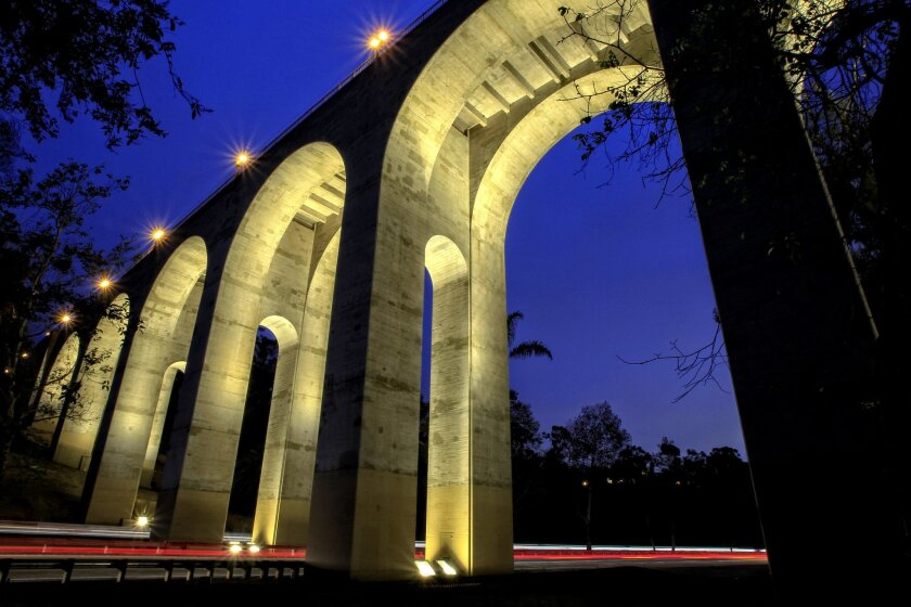 Balboa Park's Cabrillo Bridge, built by the state in 1914 for $225,155, was restored and repaired in 2014-15 by Caltrans. The $38 million project included lighting for the bridge's seven arches, adding a special glow for nighttime motorists speeding along state Route 163. The bridge was a key eleme