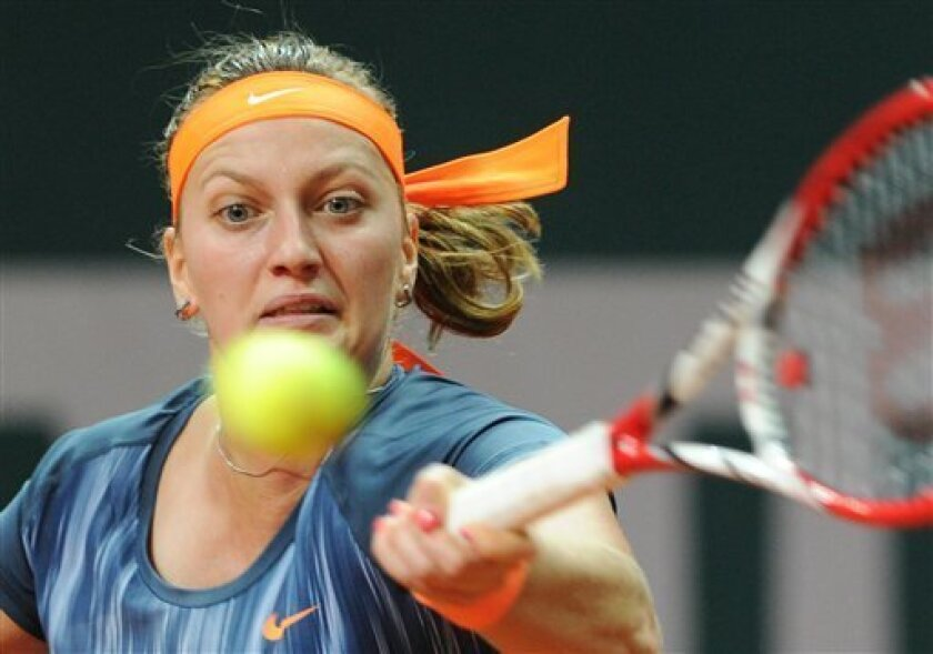 Petra Kvitova of the Czech Republic returns a shot against Roberta Vinci of Italy during the final match at the WTA Katowice Open tennis tournament in Katowice, Poland, Sunday, April 14, 2013. (AP Photo/Alik Keplicz)