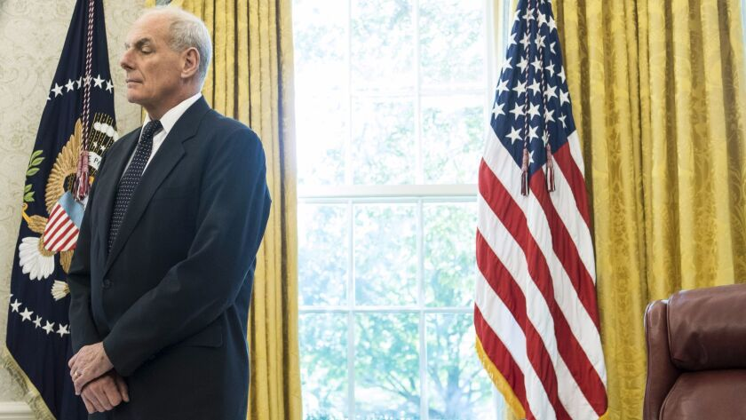 White House Chief of Staff John F. Kelly stands in the Oval Office on Oct. 19.