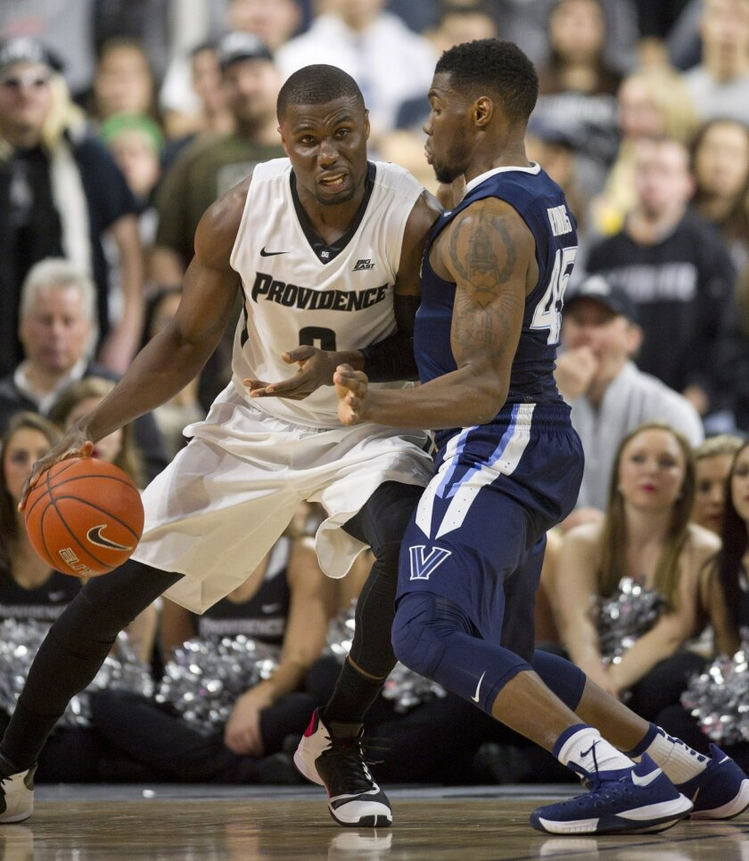Providence forward Ben Bentil (0) presses against Villanova forward Darryl Reynolds (45) during the second half of an NCAA basketball game, Saturday, Feb. 6, 2016, in Providence, R.I. (AP Photo/Gretchen Ertl)