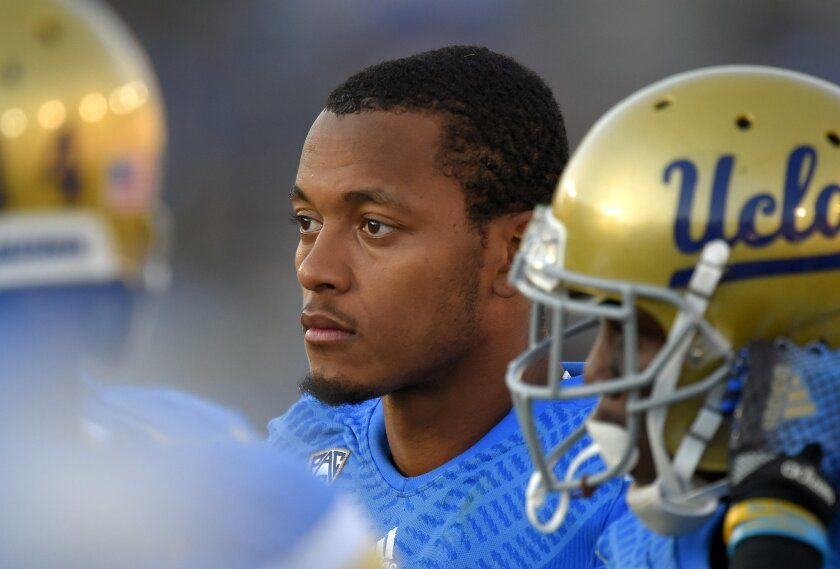 UCLA quarterback Brett Hundley, center, looks on after being taken out late in the second half of an NCAA college football game against Stanford, Friday, Nov. 28, 2014, in Pasadena, Calif. Stanford won 31-10. (AP Photo/Mark J. Terrill)