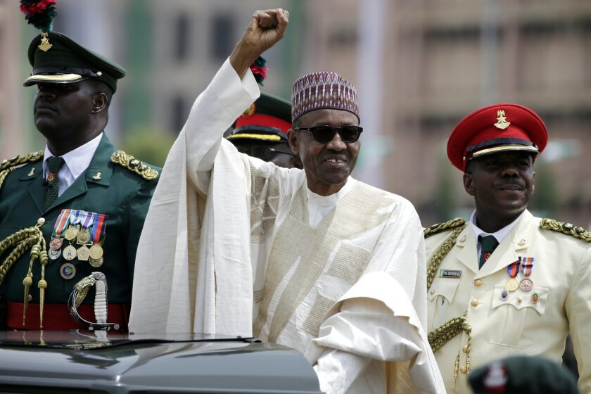 FILE - In this May 29, 2015 file photo, Nigerian President, Muhammadu Buhari, salutes his supporters during his Inauguration in Abuja, Nigeria. Nigeria's new president travels to the United States on Sunday, July 19 for a meeting with President Barack Obama to shore up relations between the U.S. and Africa's largest economy and to seek additional assistance in the fight against the Islamic extremist group Boko Haram, whose deadly rampages have killed thousands across the country's north. (AP Photo/Sunday Alamba, File)