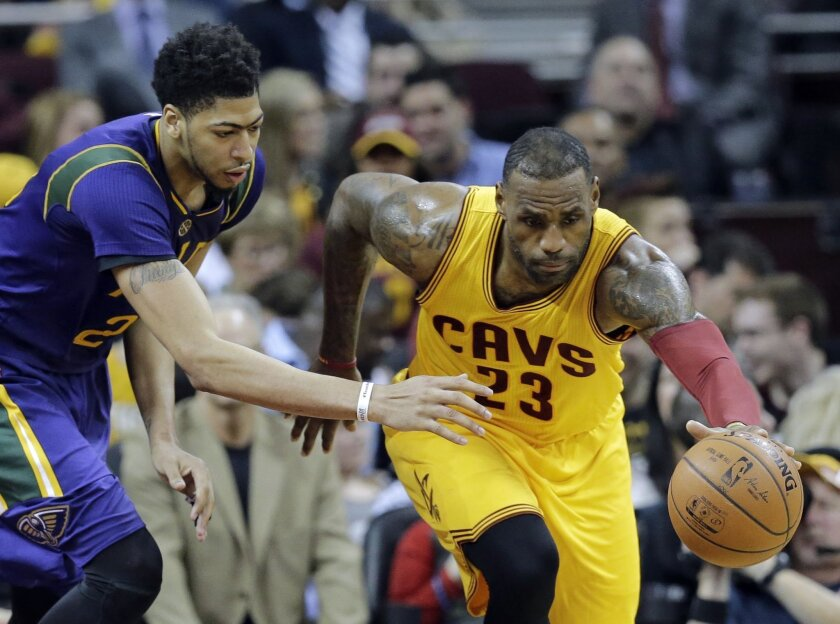 FILE - In this Saturday, Feb. 6, 2016 file photo, Cleveland Cavaliers' LeBron James, right, steals the ball from New Orleans Pelicans' Anthony Davis in the second half of an NBA basketball game Saturday, Feb. 6, 2016, in Cleveland.  (AP Photo/Tony Dejak, File)
