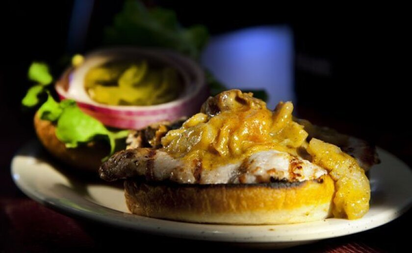 Alligator meat is ground up, topped with a curry-and-fruit tapenade, at Crazee Burger.