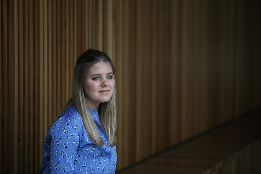 Tabitha Bell, 20, pauses for photos in Irvine, Calif., Tuesday, Aug. 4, 2020. Bell, a former student with disabilities at an elite private school in Utah, says in a lawsuit that administrators mishandled her 2017 sexual assault allegation as she endured bullying from classmates. She's seeking $10 million in damages. (AP Photo/Jae C. Hong)