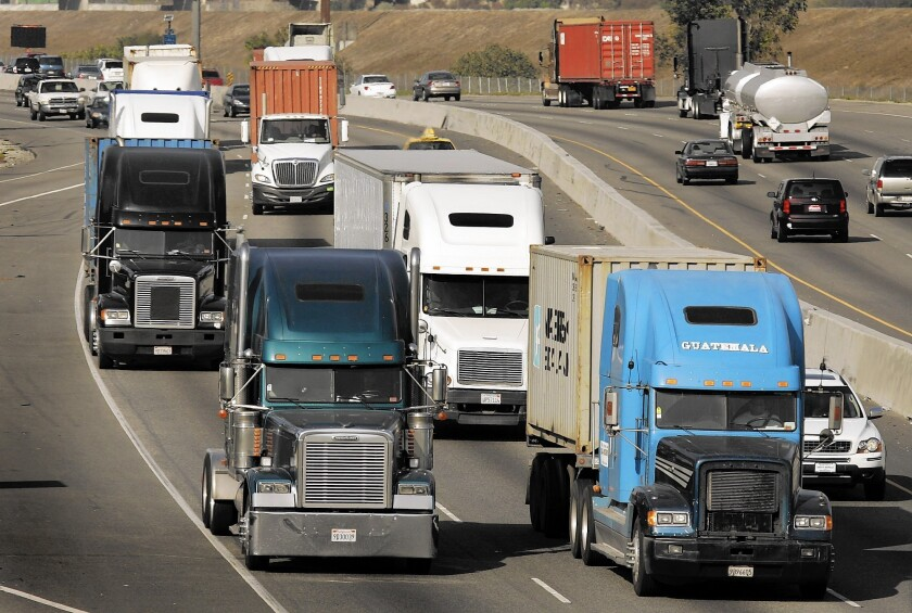 Trucks make their way along the 710 Freeway.