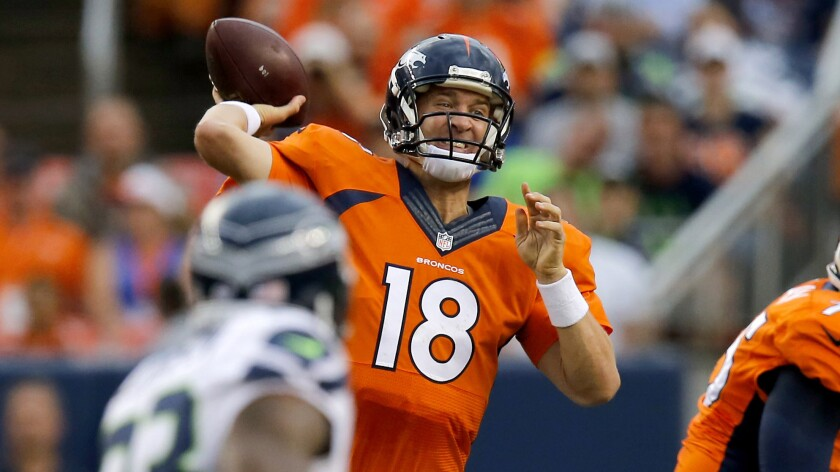 Denver Broncos quarterback Peyton Manning passes during a preseason game against the Seattle Seahawks on Thursday. Manning says the neck injury that nearly derailed his career has made him stronger mentally.