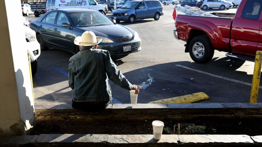 David, 70, who lives in his vehicle, enjoys a cup of coffee on a cold morning, on W. 19th St. near P