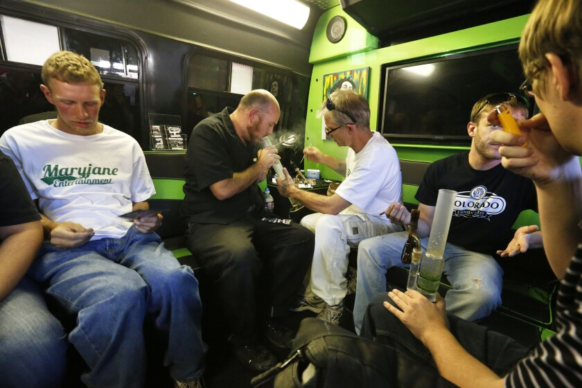 Marijuana activists and operators of a pot tour company, Maryjane Entertainment, give out free samples of marijuana in Denver. A Colorado Department of Revenue study says that income from recreational marijuana sales have been lower than had been projected.
