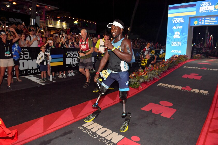 Challenged triathlete Roderick Sewell becomes the first double-leg above-knee amputee to finish the Ironman World Championship at Kailua-Kona, Hawaii, on Oct. 12. (Photo by Donald Miralle for CAF)