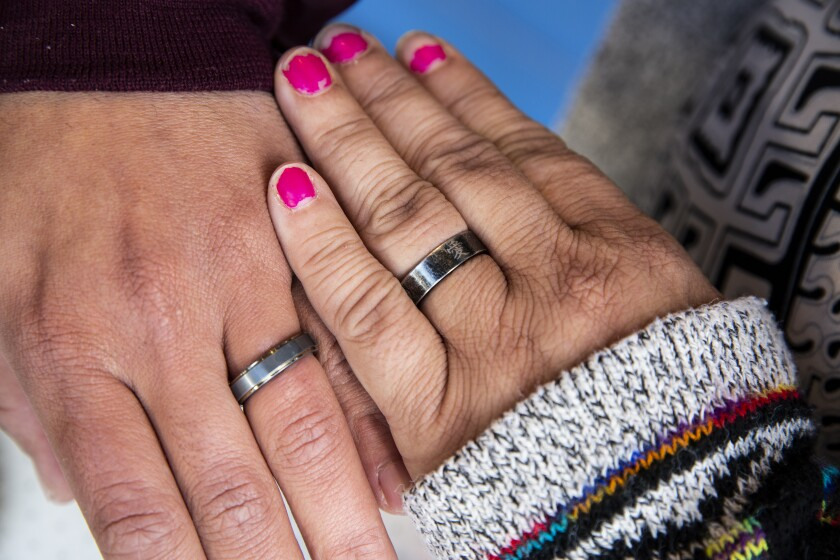 Two hands with matching rings