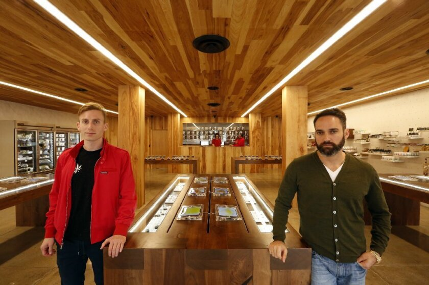 Andrew Modlin, left, co-founder and chief operating officer, and Adam Bierman, co-founder and chief executive, inside MedMen cannabis dispensary in West Hollywood. One inspiration for the shop was the Apple store.