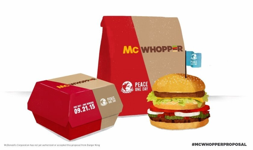"""This photo provided by Burger King shows a """"McWhopper."""" In full-page newspaper ads Wednesday, Aug. 26, 2015, Burger King said it's calling for a truce with McDonald's so that they can create a mashup of their most famous burgers, the Big Mac and the Whopper.   Burger King is tying the publicity stu"""