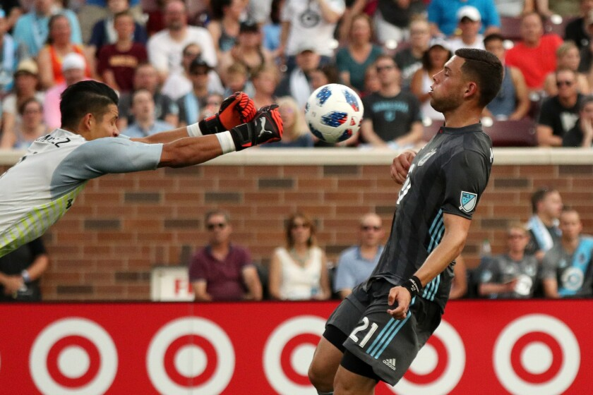 Minnesota United forward Christian Ramirez (21) hits the breaks as FC Dallas goalkeeper Jesse Gonzalez dives out to stop the ball in the first half on Friday, June 29, 2018, at TCF Bank Stadium in Minneapolis.