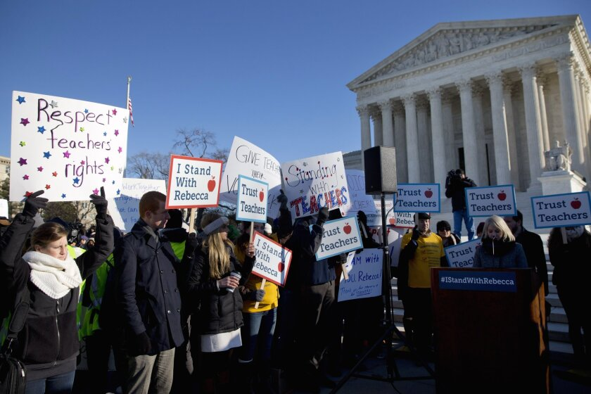 People rally at the Supreme Court as justices hear arguments in Friedrichs vs. California Teachers Assn.