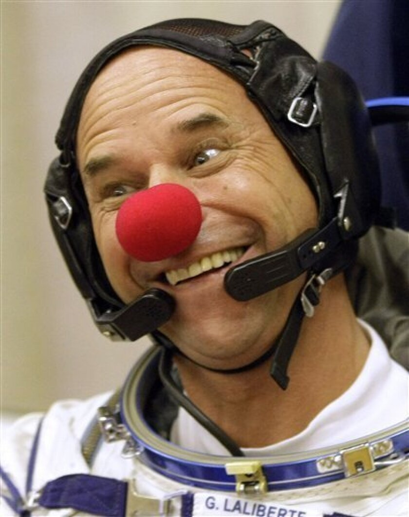 Canadian billionaire Quebec-born philanthropist Guy Laliberte crew member of the 21st mission to the International Space Station, ISS, jokes as he wears a clown nose prior to the launch of a Soyuz-FG rocket at the Russian leased Baikonur Cosmodrome, Kazakhstan, Wednesday, Sept. 30, 2009. Laliberte is due to stay at the International Space Station for nine days, before returning to earth on a Soyuz capsule on Oct. 11. (AP Photo/Mikhail Metzel)[