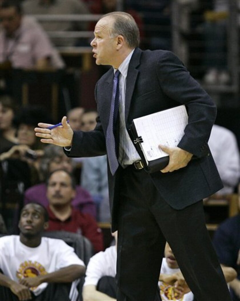 In this Dec. 12, 2008, photo, Cleveland Cavaliers assistant coach John Kuester calls a play during an NBA basketball game against the Philadelphia 76ers in Cleveland. The Detroit Pistons are close to ending their search for a new boss on the bench. The Pistons and Kuester were nearing an agreement Tuesday night, July 7, 2009, to make him their coach, a person familiar with the negotiations told The Associated Press. (AP Photo/Mark Duncan)