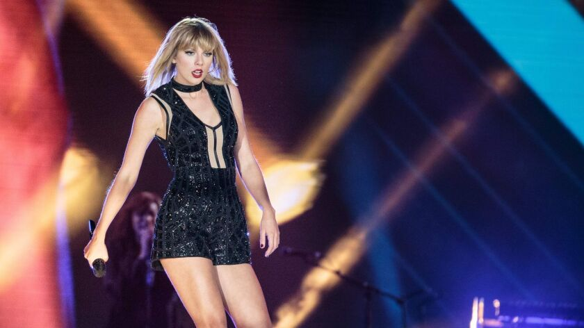 """Taylor Swift, seen performing in 2016, describes romance as a refuge from celebrity on her new album, """"Reputation."""""""