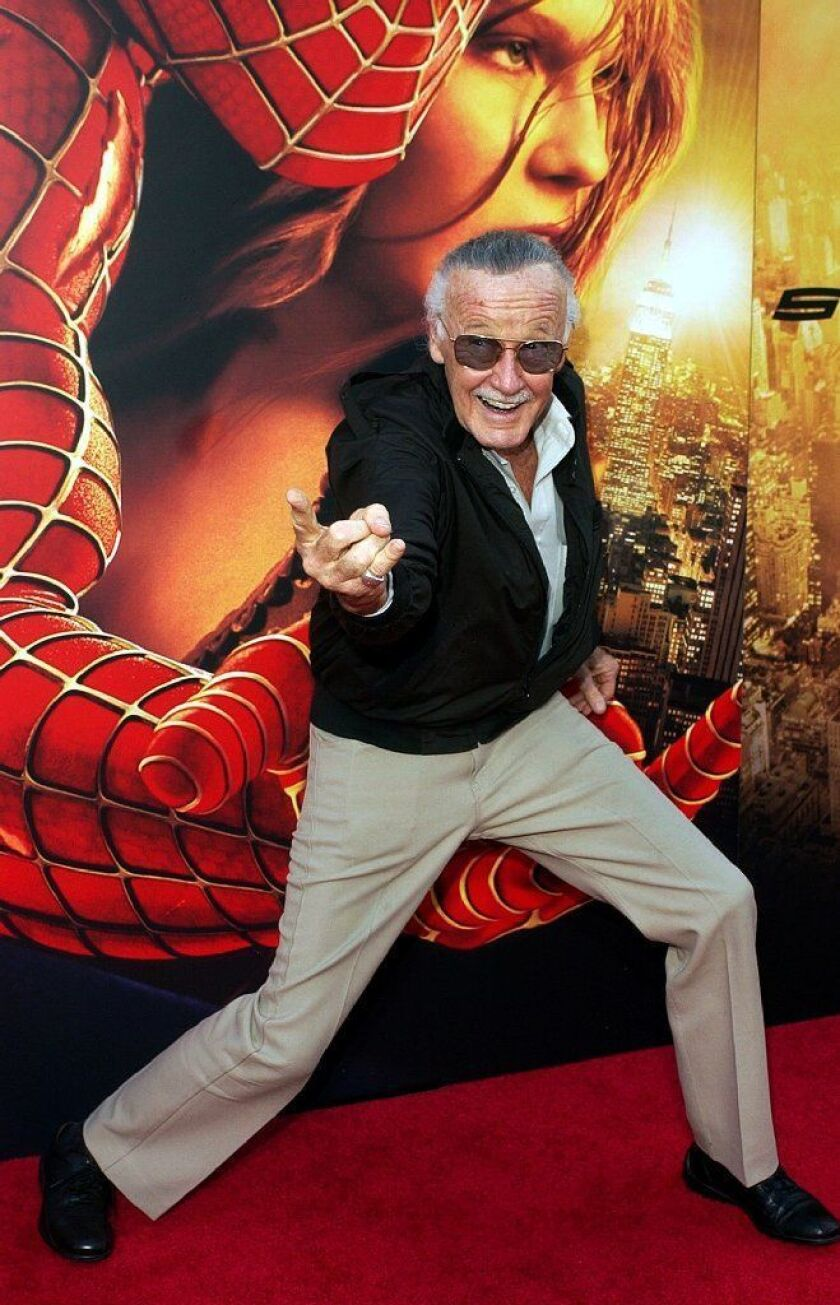 """In this June 22, 2004, file photo, Spiderman creator Stan Lee poses for photographers at the premiere of """"Spider-Man 2"""" in Los Angeles."""