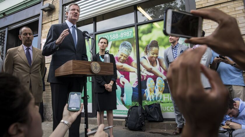 New York City Mayor Bill de Blasio speaks to reporters following a visit to a facility that holds more than 230 children who were separated from their families at the U.S.-Mexico border.