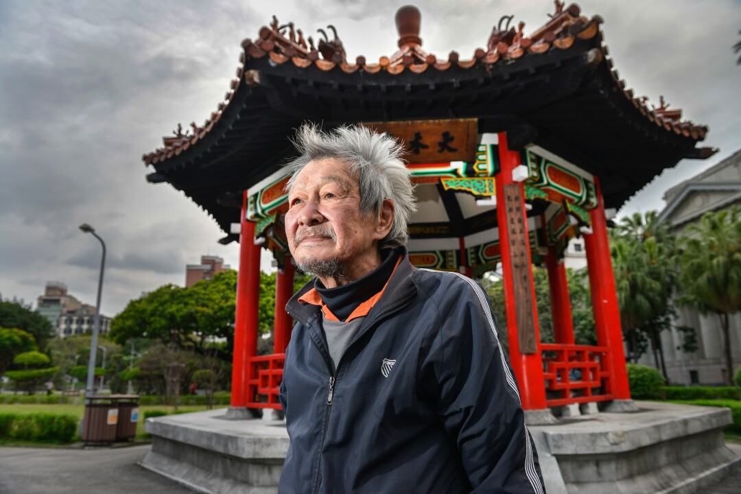 Homeless 73-year old Jimmy Bai in front of the pagoda in central Taipei's 228 Peace Park