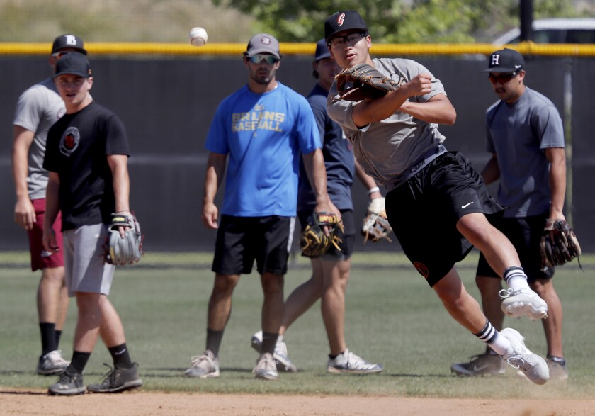 Minor league players work out at a field in Irvine.