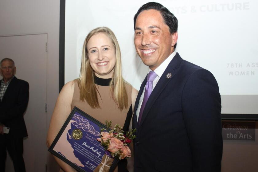 Diane Peabody Straw receives a Women of Distinction recognition from Assembly member (and mayoral candidate) Todd Gloria on March 20 in Point Loma.