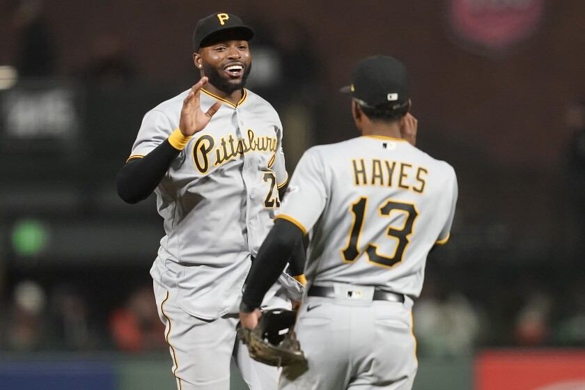Pittsburgh Pirates' Gregory Polanco, left, celebrates with Ke'Bryan Hayes (13) after the Pirates defeated the San Francisco Giants 10-2 in a baseball game in San Francisco, Saturday, July 24, 2021. (AP Photo/Jeff Chiu)