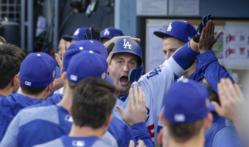 David Freese, a veteran who the Dodgers added to their roster late in the season, celebrates in the dugout after hitting a home run to lead off the first inning.