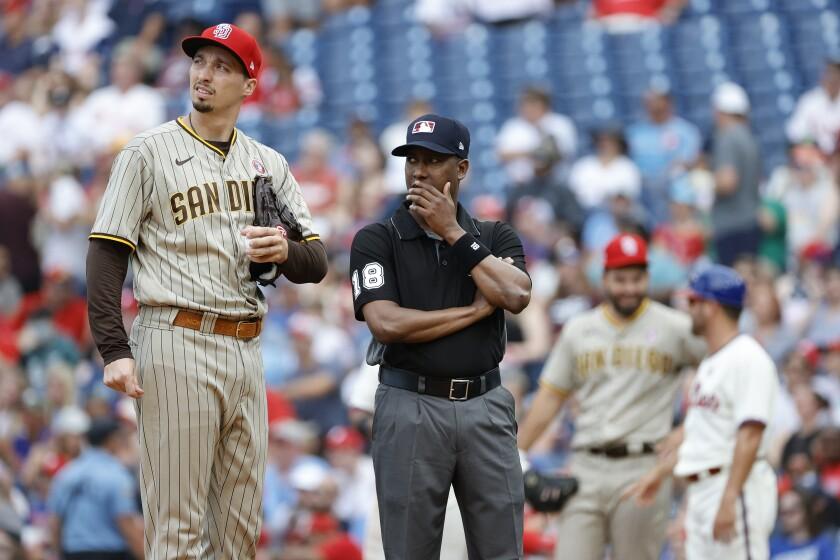 The Padres' Blake Snell and umpire Ramon De Jesus