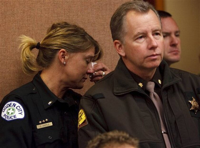 Ogden Police Lt. Danielle Croyle, left, weeps as she and fellow officers listen as Ogden Police Chief Wayne Tarwater talks about the events surrounding the shooting during a news conference Thursday, Jan. 5, 2012 in Ogden, Utah. A shootout erupted when police raided a Utah house on Wednesday evening, killing an officer and seriously wounding five others and the suspect, authorities said. The suspect, Matthew David Stewart, 37, has a limited criminal history. Stewart suffered injuries that are not life threatening, though it's unclear if he was shot. (AP Photo/The Salt Lake Tribune, Leah Hogsten) DESERET NEWS OUT; LOCAL TV