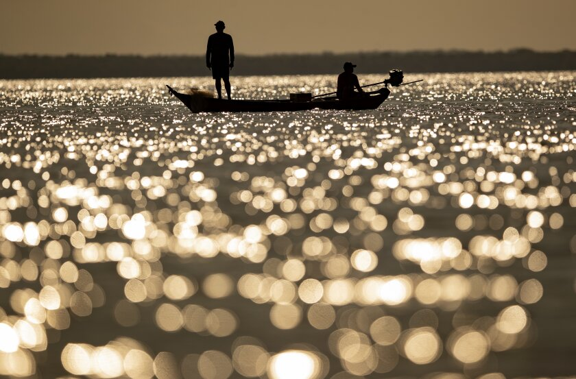 Fishermen ply their trade in the Tapajos river in Alter do Chao, Brazil, in late August.